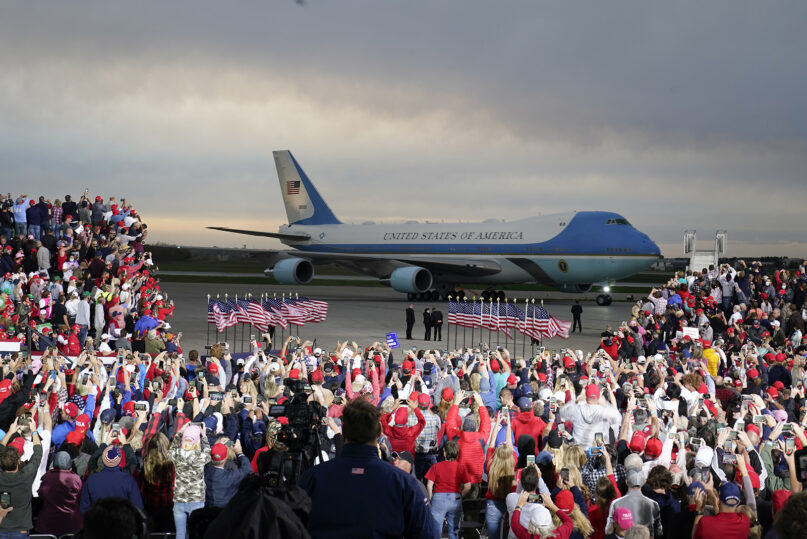 President Donald Trump arrives at a campaign rally aboard Air Force One at Des Moines International Airport on Oct. 14, 2020, in Des Moines, Iowa. (AP Photo/Charlie Neibergall)
