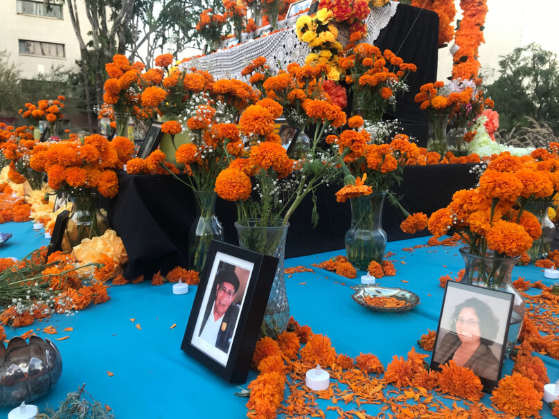 Submitted photos are displayed on a large community altar at Grand Park in downtown Los Angeles on Oct. 28, 2020. RNS photo by Alejandra Molina