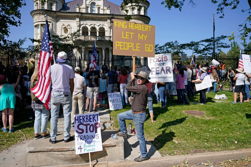 People protest Gov. Gary Herbert during a anti-mask rally outside of the Governors Mansion, Saturday, Sept. 12, 2020, in Salt Lake City. (AP Photo/Rick Bowmer)