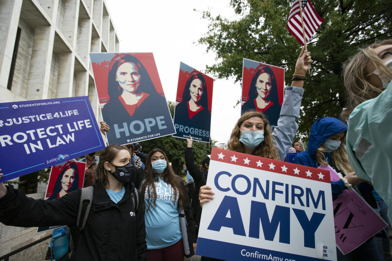 Supporters of President Donald Trump's Supreme Court nominee Amy Coney Barrett rally at Capitol Hill in Washington, Monday, Oct. 12, 2020. Barrett's confirmation hearing begins Monday before the Republican-led Senate Judiciary Committee. (AP Photo/Jose Luis Magana)