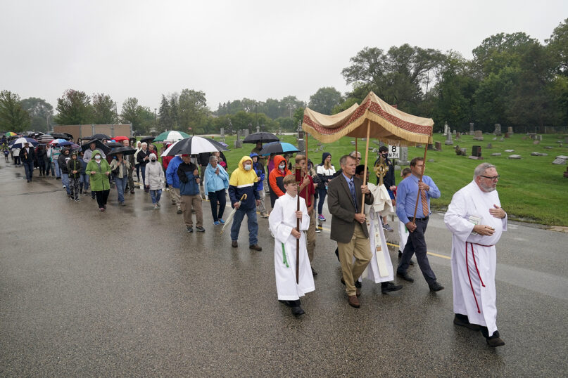 Churchgoers participate in a procession at Holy Apostles Catholic Church in Milwaukee, on Sept. 12, 2020. (AP Photo/Morry Gash)