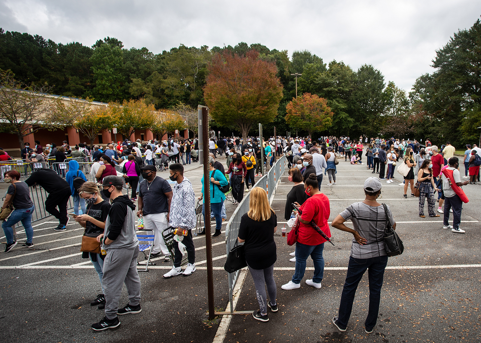 Hundreds of people wait in line for early voting in Marietta, Georgia, on Oct. 12, 2020. (AP Photo/Ron Harris, File)