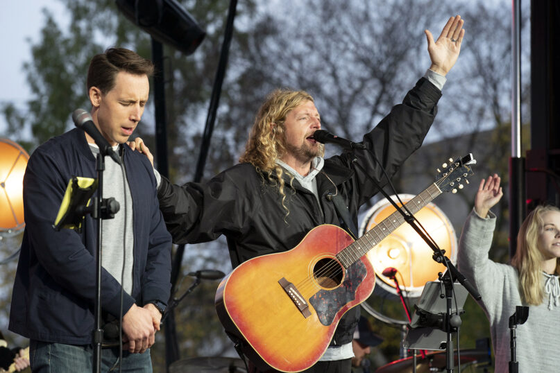 Christian musician Sean Feucht, right, prays with Sen. Josh Hawley, R-Mo., left, during a rally at the National Mall in Washington, Sunday, Oct. 25, 2020. (AP Photo/Jose Luis Magana)