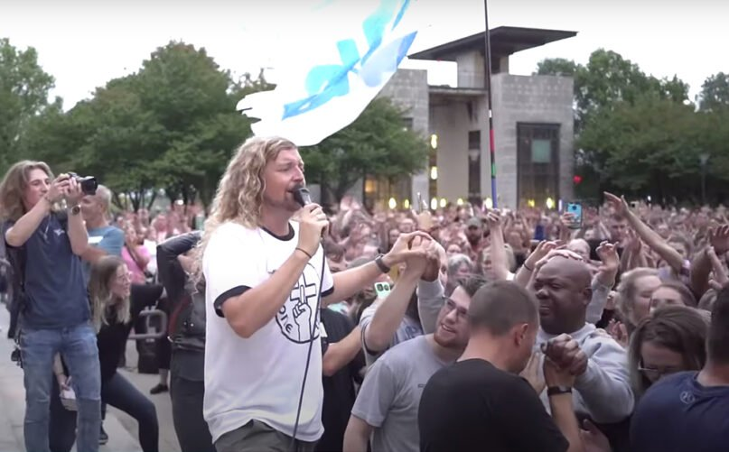 Christian musician Sean Feucht, center, left, leads a worship service in front of the Nashville Metropolitan Courthouse, Sunday, Oct. 11, 2020, in Nashville. Video screengrab