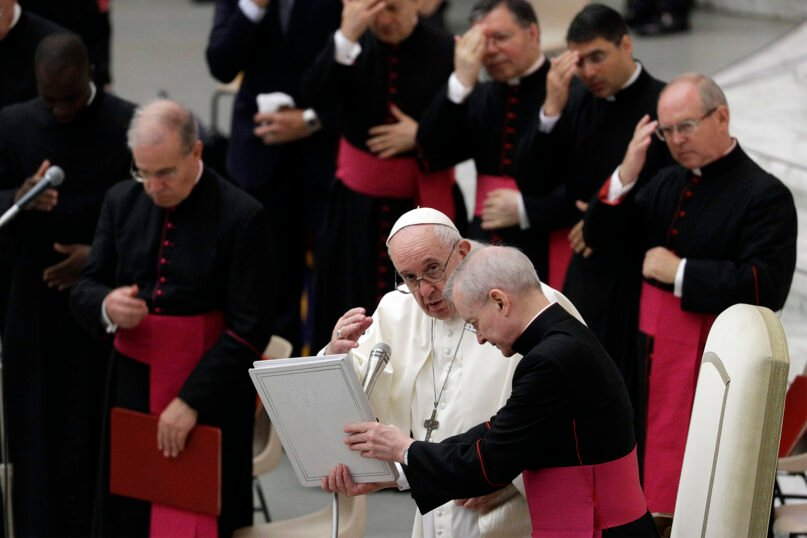 Pope Francis delivers his blessing in the Paul VI hall on the occasion of the weekly general audience at the Vatican, Wednesday, Oct. 7, 2020. (AP Photo/Gregorio Borgia)