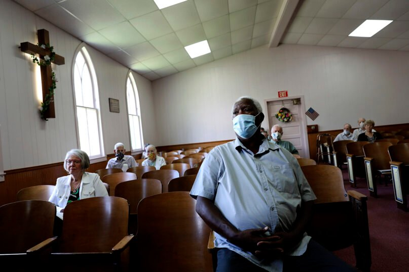 Milton L. McDaniel Sr. attends a service at Boskydell Baptist Church, Sunday, Aug. 2, 2020, in Carbondale, Illinois. (AP Photo/Wong Maye-E)