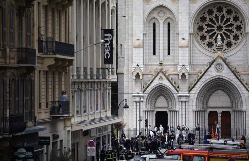Police officers work at the Basilica of Notre-Dame in Nice, southern France, after a knife attack took place on Oct. 29, 2020. The attacker killed at least three people at the church, prompting the prime minister to announce that France was raising its security alert status to the highest level. (AP Photo/Daniel Cole)