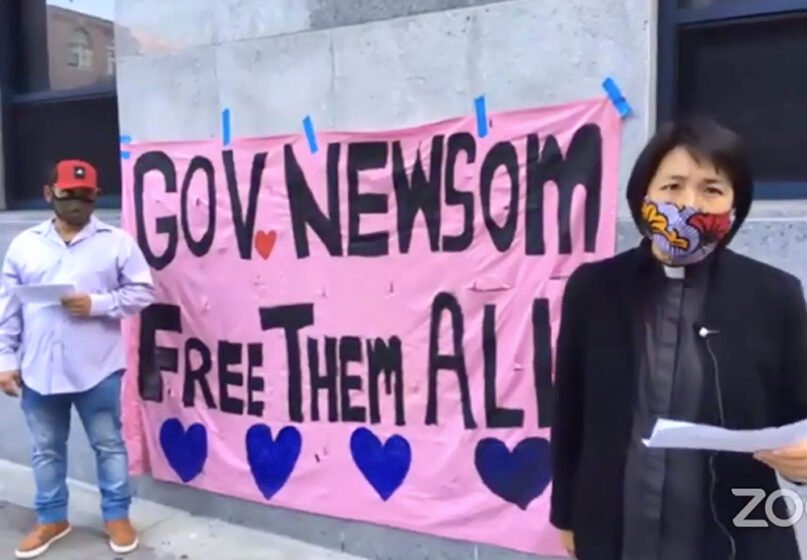 The Rev. Deborah Lee, right, executive director of Interfaith Movement for Human Integrity, speaks outside an ICE facility in San Francisco during a virtual conference. Video screengrab