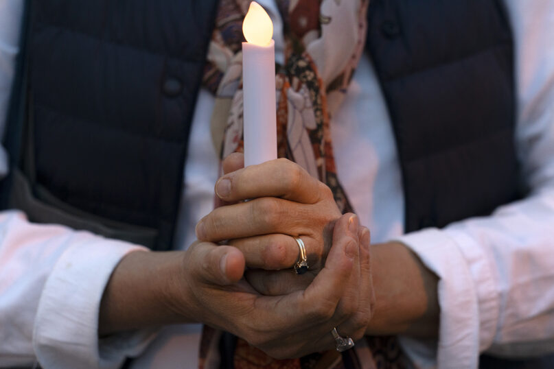 Amy Sommers, of Seattle, prays while attending the