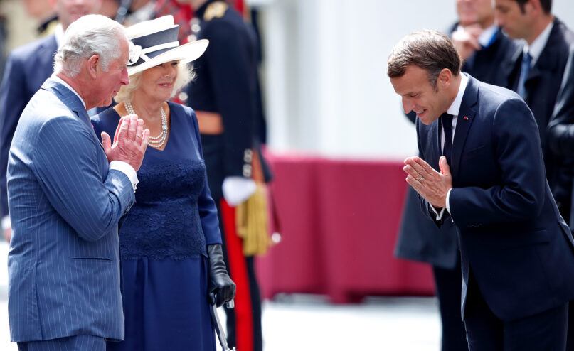 Prince Charles, accompanied by Camilla, Duchess of Cornwall, and French president Emmanuel Macron greet one another with a 'namaste' in London on June 18, 2020. (Photo by Max Mumby/Indigo/Getty Images)