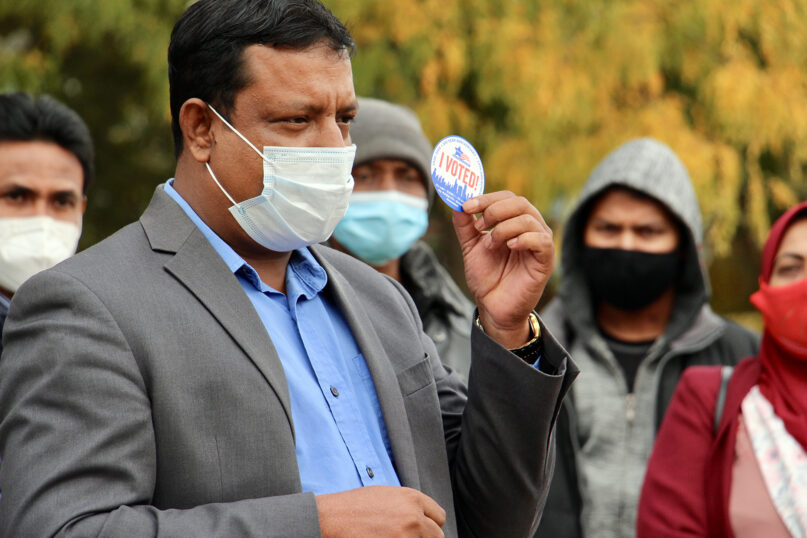Nasir Zakaria, founder and executive director of the Rohingya Culture Center of Chicago, speaks about voting Oct. 20, 2020, at an early voting site in the Rogers Park neighborhood on the north side of Chicago. RNS photo by Emily McFarlan Miller