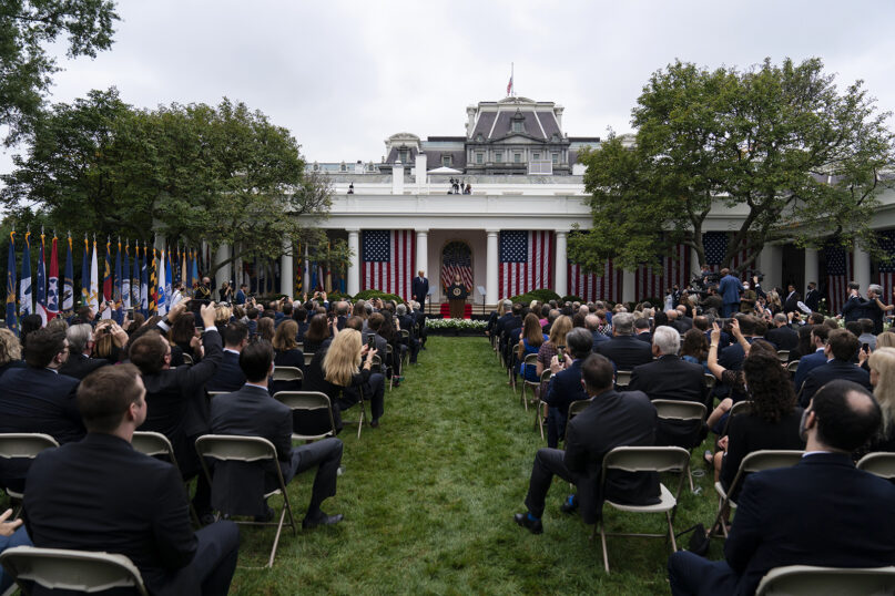 Judge Amy Coney Barrett, center, speaks with President Donald Trump at left, as he announces Barrett as his nominee to the Supreme Court, in the Rose Garden at the White House, Saturday, Sept. 26, 2020, in Washington. (AP Photo/Alex Brandon)