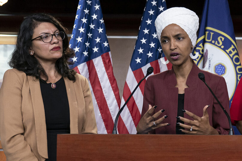 In this July 2019 file photo, U.S. Rep. Ilhan Omar, D-Minnesota, right, speaks as U.S. Rep. Rashida Tlaib, D-Michigan, listens during a news conference at the Capitol in Washington. Both representatives were reelected to their positions in Congress this week. (AP Photo/J. Scott Applewhite, File)