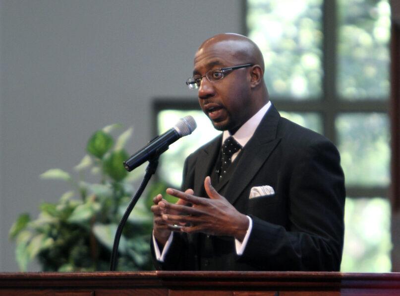 The Rev. Raphael Warnock delivers a sermon to congregants at Ebenezer Baptist Church on Oct. 31, 2010, in Atlanta. (AP Photo/David Goldman)
