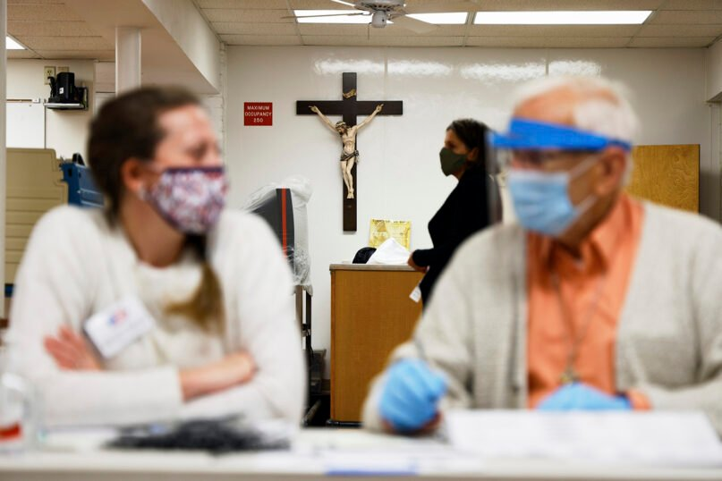 Christ on the cross is seen at a polling station on the lower level of Our Lady of Lourdes Catholic Church in Omaha, Nebraska, on Nov. 3, 2020. (AP Photo/Nati Harnik)
