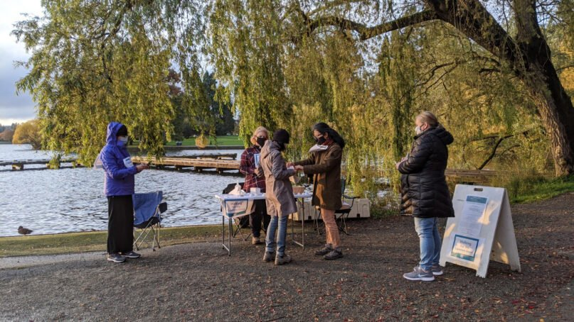 """People arrive for """"Walking for the Common Good"""" at Green Lake in Seattle on Nov. 3, 2020. Photo courtesy of Cara Tanis"""