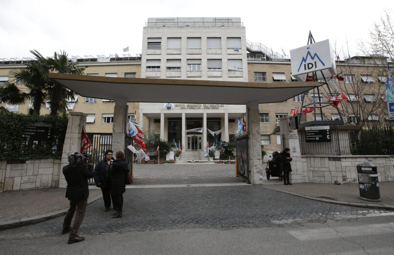 A cameraman films the Immaculate Dermatological Institute, or IDI, in Rome, Thursday, April 4, 2013. (AP Photo/Andrew Medichini)