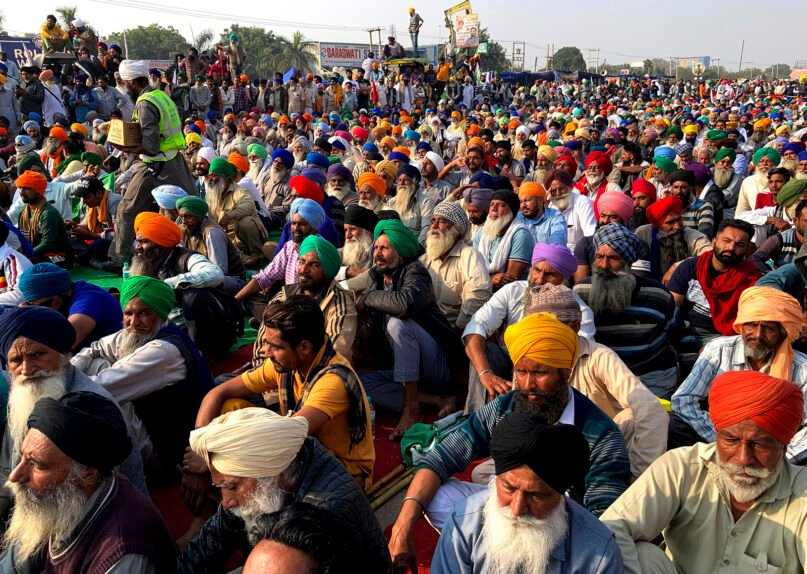 Indian farmers protesting new agriculture laws hold a meeting at the Delhi-Haryana state border, Monday, Nov. 30, 2020. Indian Prime Minister Narendra Modi tried to placate thousands of farmers protesting new agriculture laws Monday. While trying to march toward New Delhi, the farmers, using their tractors, have cleared concrete blockades, walls of shipping containers and horizontally parked trucks after police had set them up as barricades and dug trenches on highways to block roads leading to the capital. (AP Photo/Rishi Lekhi)