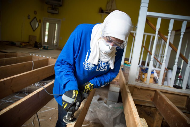 An Islamic Relief volunteer works on floor joints in an Islamic Relief USA home rebuilding project in Tarboro, North Carolina, in 2017. The town saw severe damage in the wake of Hurricane Matthew. Photo courtesy of Islamic Relief