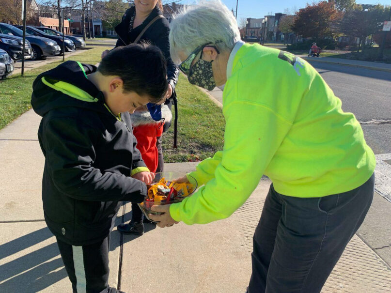 Sister Reg McKillip hands out candy at a polling place Nov. 3, 2020, in Wisconsin. Photo courtesy of Brittany Koteles