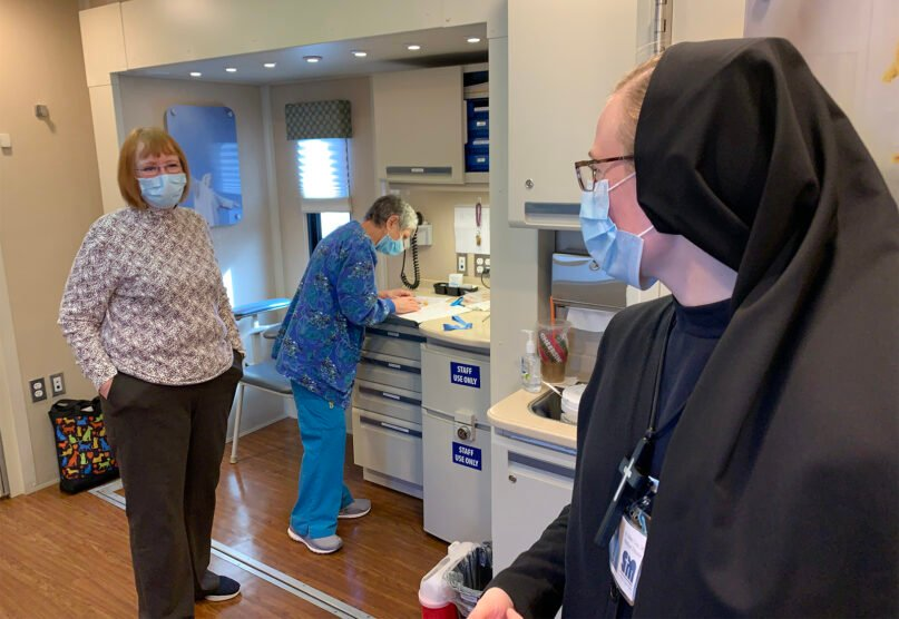 Sister Mary Lisa Renfer, right, medical director of the St. Mary's Legacy Clinic, chats with volunteers Marlie Clay, left, and Patti Pemberton during a stop at Crab Orchard Christian Church in Crab Orchard, Tennessee, Tuesday, Nov. 10, 2020. RNS photo by Bob Smietana
