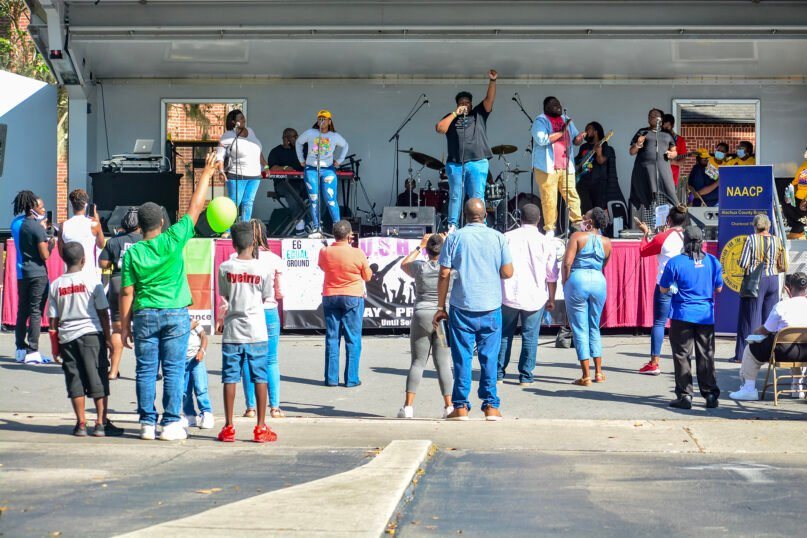 """Attendees gather around the stage at a """"Souls to the Polls"""" event in Alachua County, Florida, on Oct. 31, 2020. Photo by Latecia Richards"""
