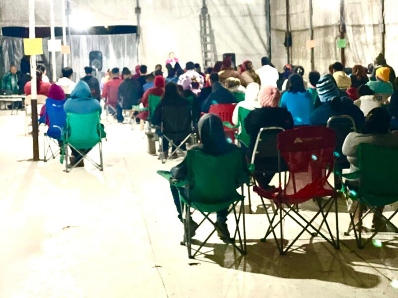 People gather together for an all-night prayer vigil organized by evangelical Christians at a camp for asylum-seekers in Matamoros, Mexico. Courtesy of Alma Ruth