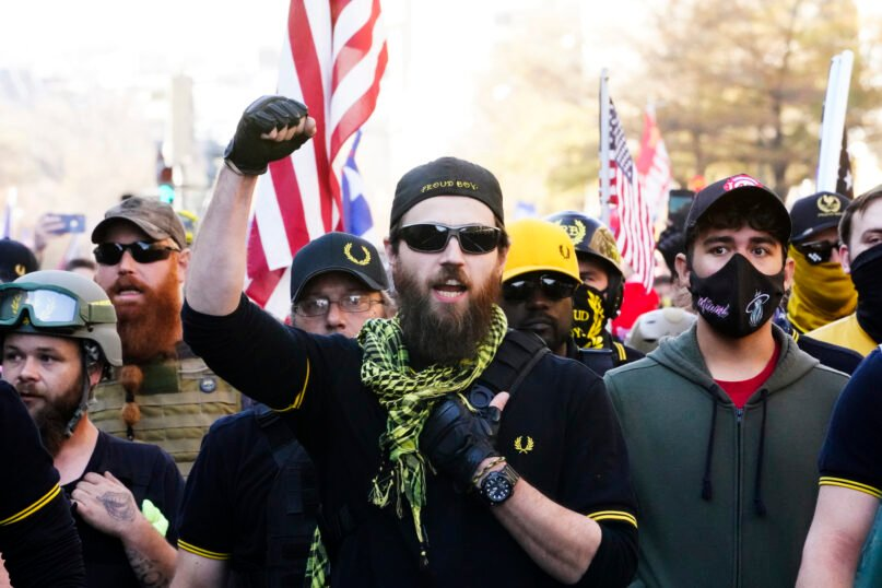 People identifying themselves as members of the Proud Boys join supporters of President Donald Trump as they march Saturday, Nov. 14, 2020, in Washington. (AP Photo/Jacquelyn Martin)