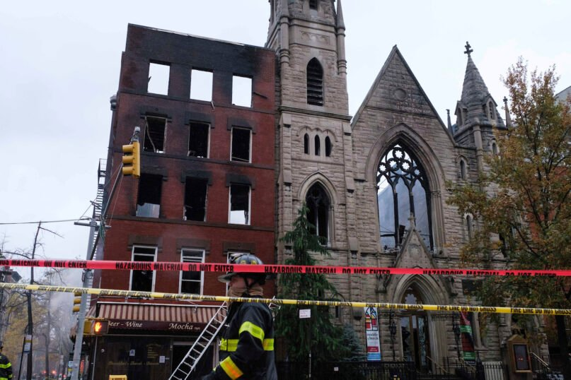 Firefighters work to extinguish a fire that erupted from the building next to Middle Collegiate Church on Saturday, Dec. 5, 2020 in New York. The historic 19th-century church in lower Manhattan was gutted by a massive fire early Saturday that sent flames shooting through the roof. (AP Photo/Yuki Iwamura)