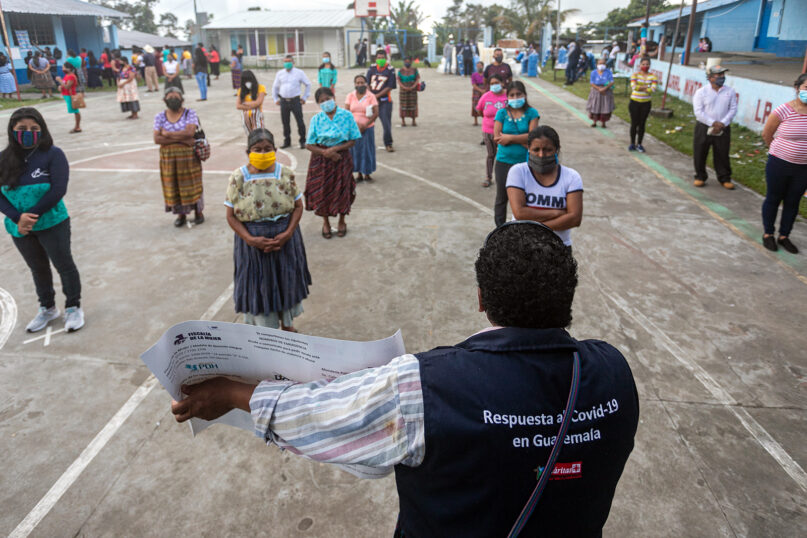 Catholic Relief Services staff educate local residents on ways to prevent the spread of COVID-19 in Tajumulco, San Marcos, Guatemala, in November 2020. The program in which 89,880 people will participate in total, with the support of the United States Office for Foreign Disaster Assistance (USAID / OFDA) and local partner Cáritas San Marcos, aims to reduce the transmission of COVID-19. Photo by Eric Salguero/Cinema Studio for Catholic Relief Services