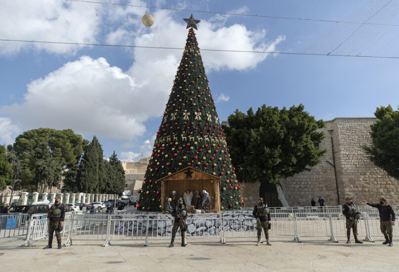 A Palestinian National security unit is deployed in Manger Square, adjacent to the Church of the Nativity, traditionally believed by Christians to be the birthplace of Jesus Christ, ahead of Christmas, in the West Bank city of Bethlehem, Dec. 23, 2020. (AP Photo/Nasser Nasser)