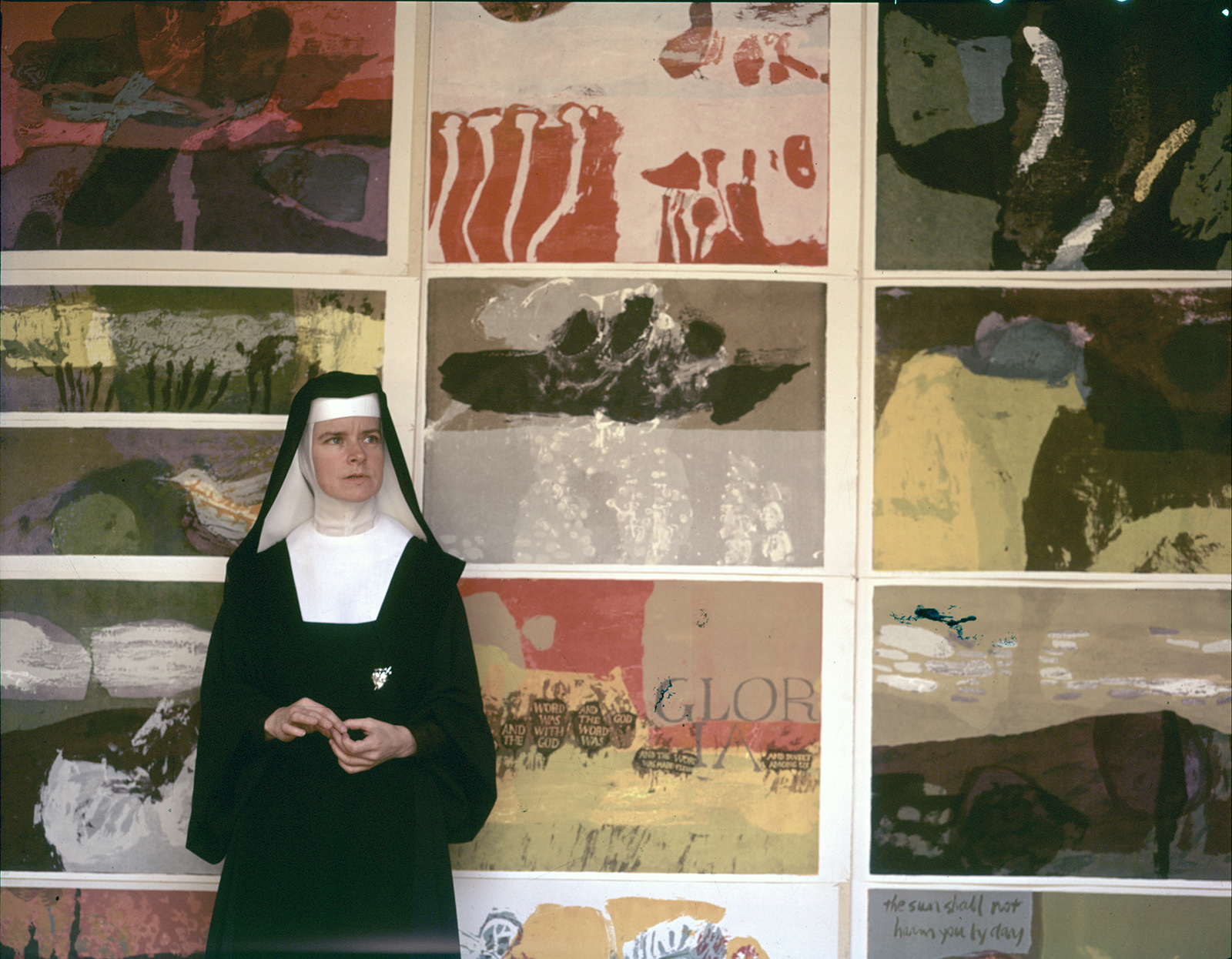 Corita Kent, known as Sister Mary Corita, in front of some of her artwork. Photo courtesy of Corita Art Center/Immaculate Heart Community