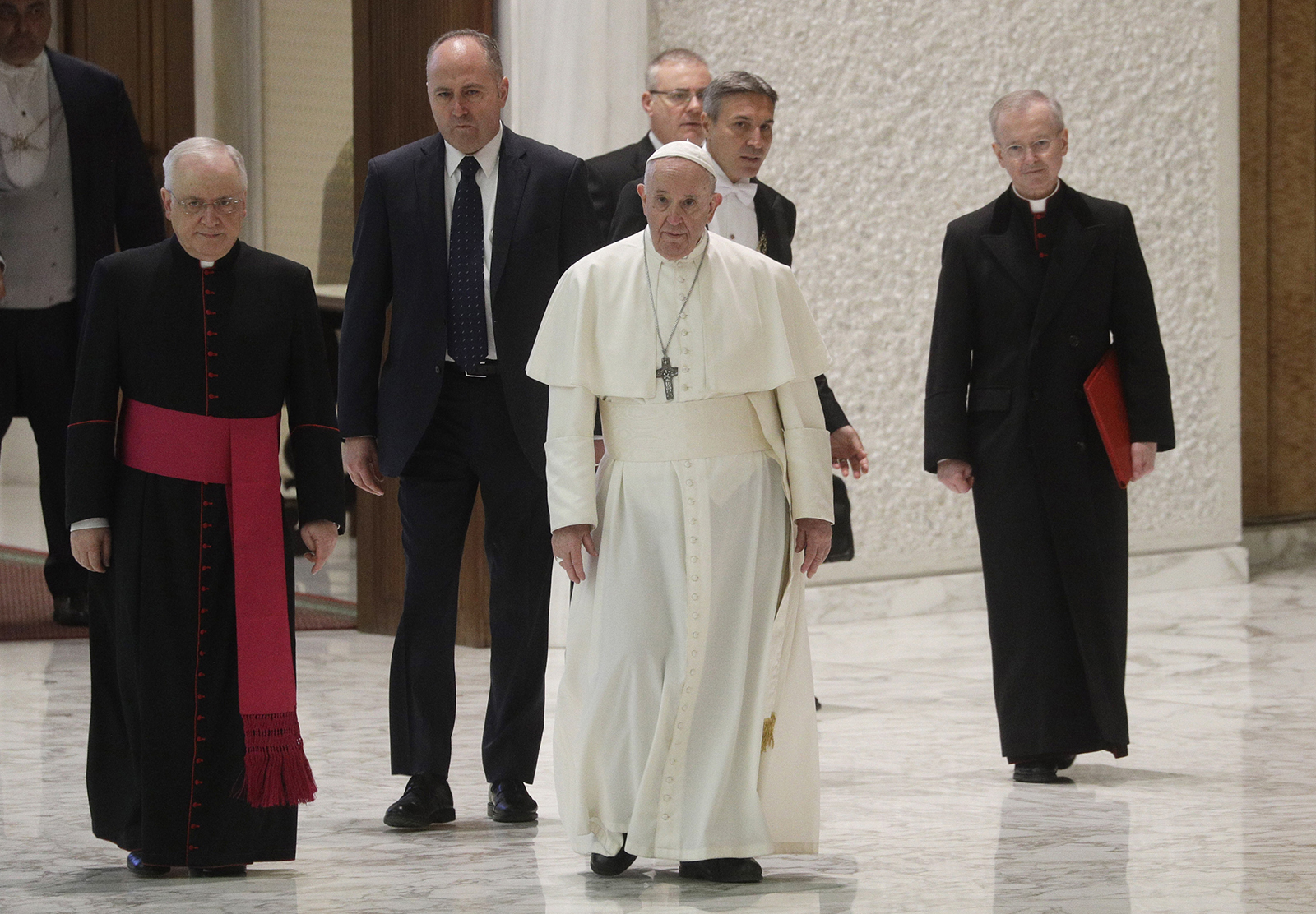 In this Dec. 21, 2020, file photo, Pope Francis exchanges holiday greetings with Vatican employees in the Paul VI Hall at the Vatican. (AP Photo/Gregorio Borgia, file)