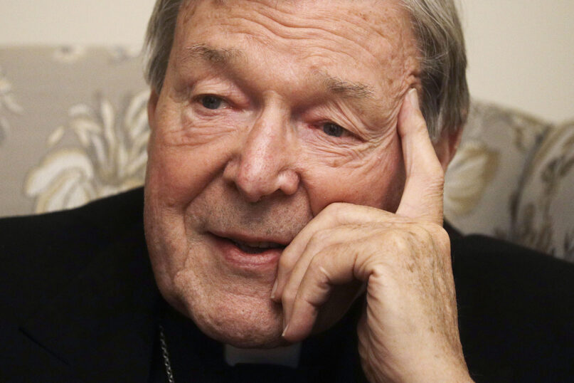 Cardinal George Pell answers a journalist's question during an interview with The Associated Press inside his residence near the Vatican in Rome on Nov. 30, 2020. The pope's former treasurer, who was convicted and then acquitted of sexual abuse in his native Australia, said he feels a dismayed sense of vindication as the financial mismanagement he tried to uncover in the Holy See is now being exposed in a spiraling Vatican corruption investigation. (AP Photo/Gregorio Borgia)