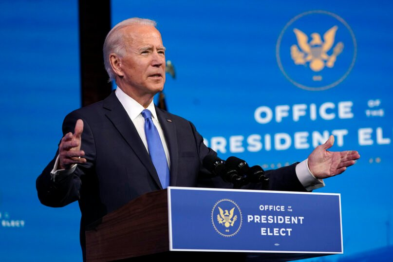 President-elect Joe Biden speaks on Dec. 14, 2020, at The Queen theater in Wilmington, Delaware, after the Electoral College formally elected him as president. (AP Photo/Patrick Semansky)