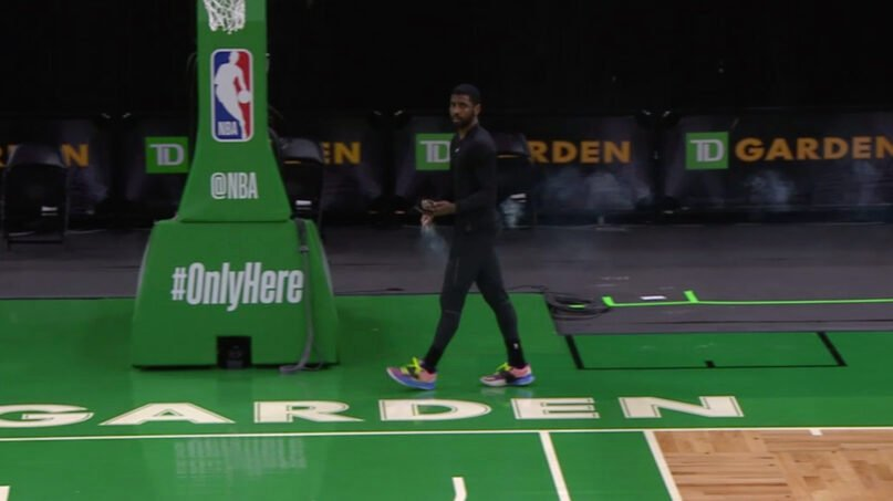 Brooklyn Nets guard Kyrie Irving burns sage around the court before a preseason NBA game against the Boston Celtics at TD Garden Arena, Friday, Dec. 18, 2020, in Boston. Video screengrab