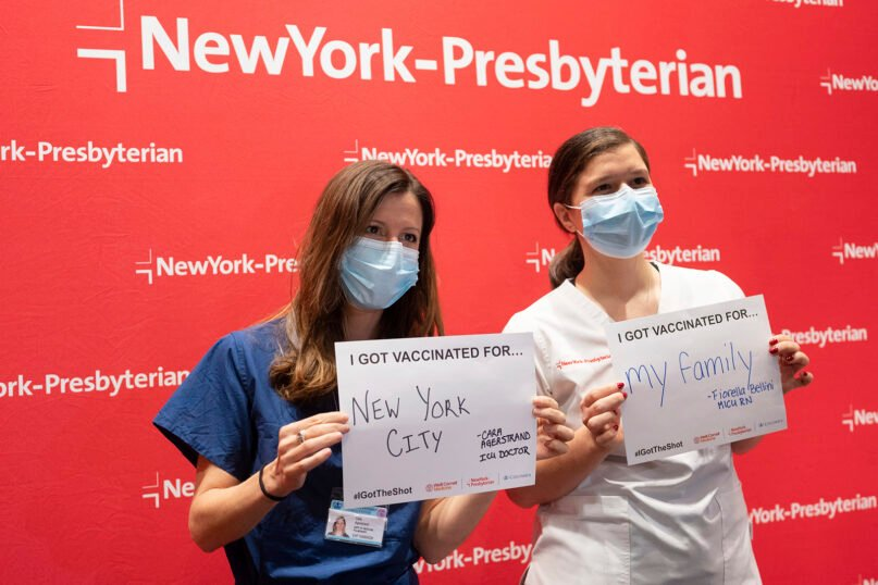 NewYork-Presbyterian/Columbia University Irving Medical Center's Dr. Cara Agerstrand, left, a critical care physician and pulmonologist, and Fiorella Bellini, an intensive care unit nurse, share why they got the COVID-19 vaccine, Dec. 15, 2020, in New York. (Diane Bondareff/AP Images for NewYork-Presbyterian)