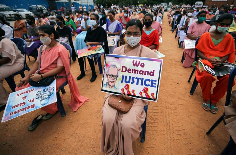 A Christian nun, center, and others hold placards demanding the release of tribal rights activist Stan Swamy as they listen to a speaker during a demonstration in Bengaluru, India, on Nov.12, 2020. The 83-year-old Jesuit priest was arrested by the National Investigation Agency for alleged Maoist links. (AP Photo/Aijaz Rahi)