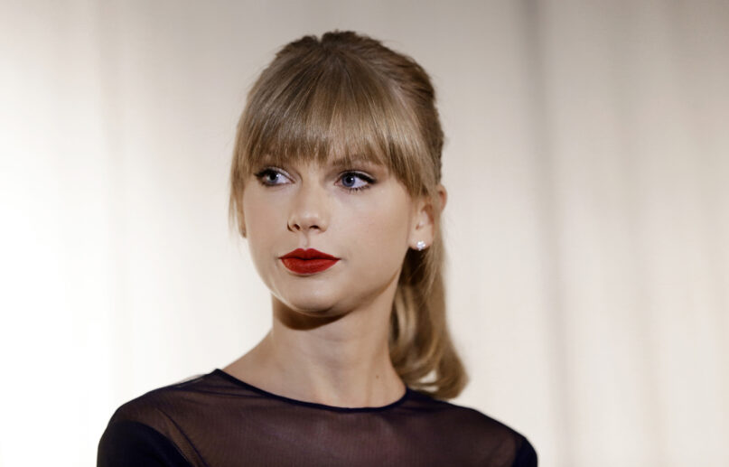 In this Oct. 12, 2013, file photo, Taylor Swift appears at the Country Music Hall of Fame and Museum in Nashville, Tennessee. (AP Photo/Mark Humphrey)