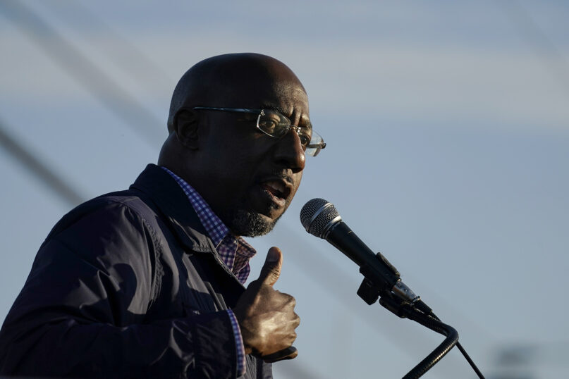 The Rev. Raphael Warnock, a Democratic candidate for the U.S. Senate, speaks during a campaign rally on Sunday, Nov. 15, 2020, in Marietta, Georgia. Warnock and U.S. Sen. Kelly Loeffler are in a runoff election for the Senate seat. (AP Photo/Brynn Anderson)