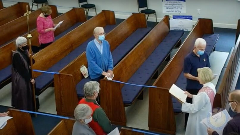 Socially distanced congregants attend a service at Holy Comforter Episcopal Church in Tallahassee, Florida, on Dec. 13, 2020. Video screengrab