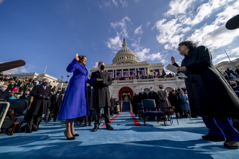 Kamala Harris is sworn in as vice president by Supreme Court Justice Sonia Sotomayor as her husband, Doug Emhoff, holds the Bible during the 59th Presidential Inauguration at the U.S. Capitol in Washington, Jan. 20, 2021. (AP Photo/Andrew Harnik, Pool)