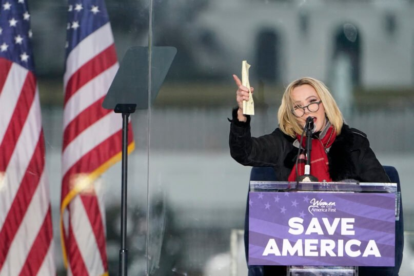 In this Jan. 6, 2021, file photo, Pastor Paula White leads a prayer in Washington, at a rally in support of President Donald Trump called the