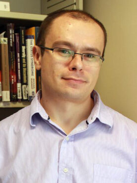 Adam Okulicz-Kozaryn. Photo via Rutgers University
