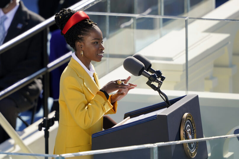 American poet Amanda Gorman reads a poem during the 59th Presidential Inauguration at the U.S. Capitol in Washington, Wednesday, Jan. 20, 2021. (AP Photo/Carolyn Kaster)