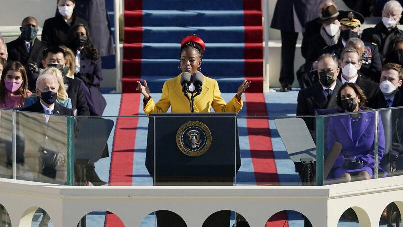 National youth poet laureate Amanda Gorman recites her inaugural poem during the 59th Presidential Inauguration at the U.S. Capitol in Washington, Jan. 20, 2021. (AP Photo/Patrick Semansky, Pool)