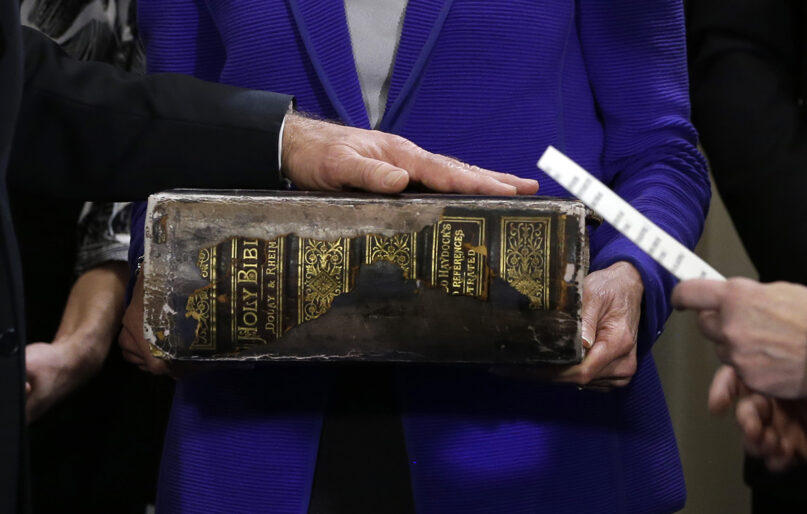 Vice President Joe Biden, left, places his hand on the Biden family Bible held by his wife Jill Biden, center, as he takes the oath of office from Supreme Court Justice Sonia Sotomayor, right, during an official ceremony at the Naval Observatory on Jan. 20, 2013, in Washington. (AP Photo/Carolyn Kaster)