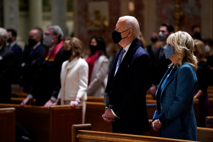 President-elect Joe Biden is joined his wife, Jill Biden, as they celebrate Mass at the Cathedral of St. Matthew the Apostle during Inauguration Day ceremonies Jan. 20, 2021, in Washington. (AP Photo/Evan Vucci)
