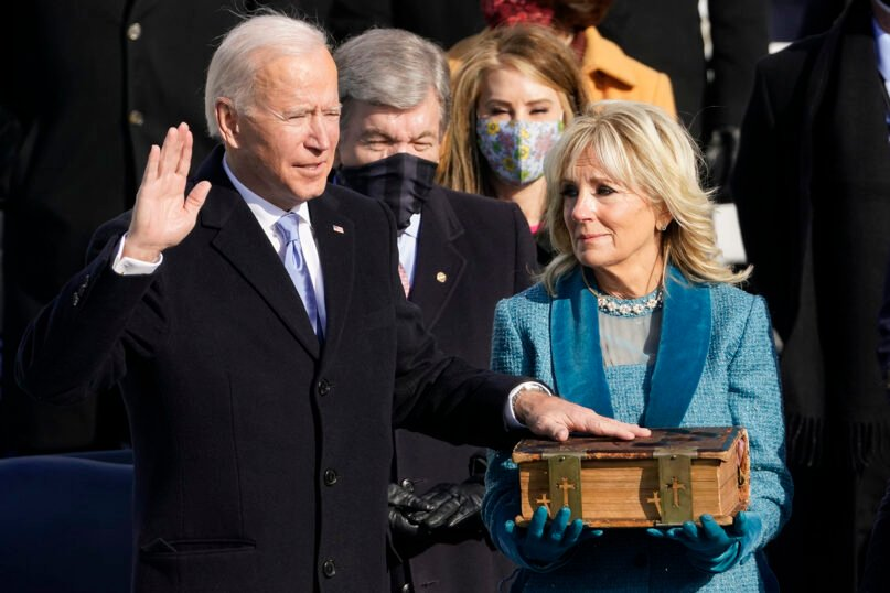 Joe Biden is sworn in as the 46th president of the United States by Chief Justice John Roberts, as Jill Biden holds the Bible, during the 59th Presidential Inauguration at the U.S. Capitol in Washington, Jan. 20, 2021. (AP Photo/Andrew Harnik)
