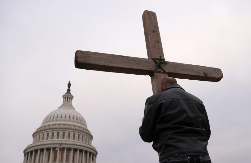 Supporters of U.S. President Donald Trump put up a Cross outside the U.S. Capitol on Jan. 6, 2021. (Photo by Win McNamee/Getty Images)